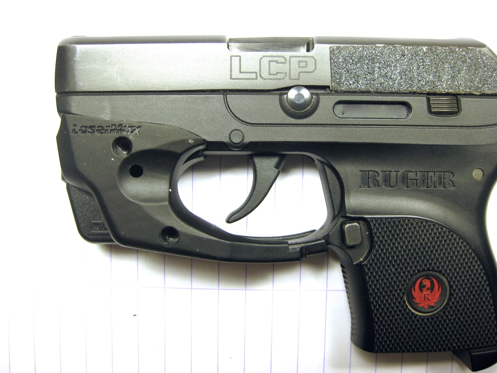 self defense carry: Dueling Lasers: LaserMax & Crimson Trace