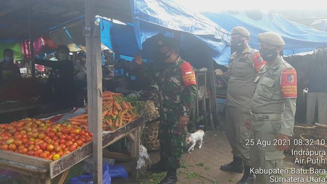 Patroli Yustisi Covid-19 Di Pajak Delima Indrapura Dilakukan Oleh Personel Jajaran Kodim 0208/Asahan