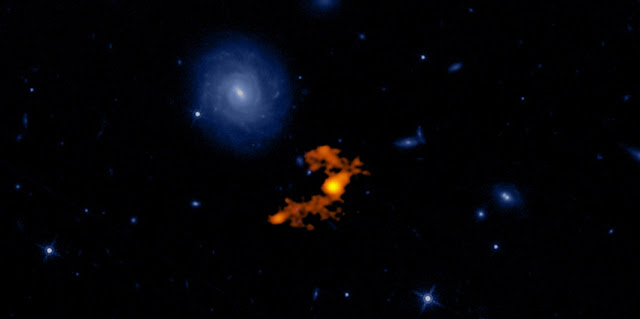 Composite image of W2246-0526 and its three companion galaxies shown in the ALMA portion of the image (orange). The blue background is an optical image of the same region from Hubble. Credit: ALMA (ESO/NAOJ/NRAO);T. Díaz-Santos et al.; N. Lira