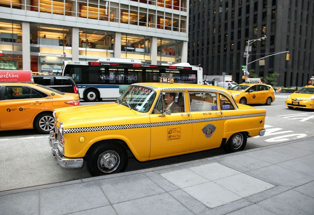 New York Hilton Midtown Hotel welcomes bees at its rooftop and arrive with a vintage yellow taxi