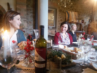 A bottle of Chianti shared by the guests of a Tuscan Christmas gathering