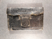 "A worn case with the words ""Diary 1864"" stamped on it."
