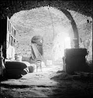 Strucure of unknown function found under the Greek Orthodox church of Agios Minas (19th century), October 1936. It was discovered in 1935 by German archaeologist Alfons Maria Schneider. When Artamonoff photographed it a year later, the arched chamber had been converted into storage space. In the 1970s, it was part of a carpenter's workshop [Credit: © Nicholas V. Artamonoff Collection, Image Collections and Fieldwork Archives, Dumbarton Oaks]