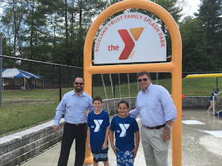Hockomock Area YMCA Board of Directors Vice Chairman Bill Chouinard (far left) and Hockomock Area YMCA Board of Directors Chairman Brian Earley (far right) with YMCA members Aiden Cohen (second from left) and Ryan Martin (third from left)