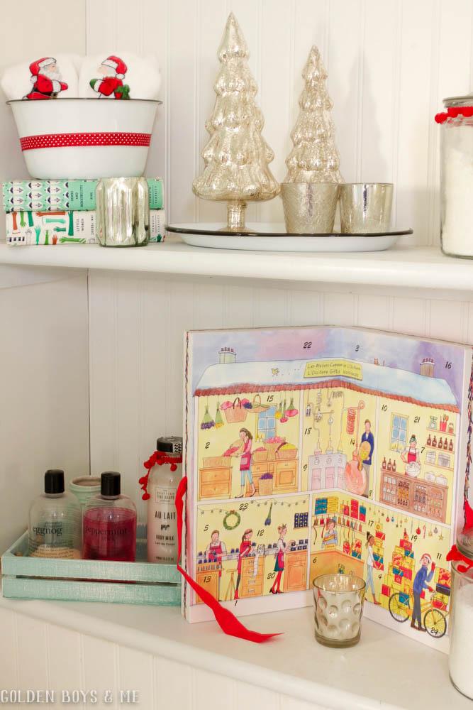 DIY built in shelves in master bathroom with Christmas decor, mercury glass  and L'Occitane Advent Calendar