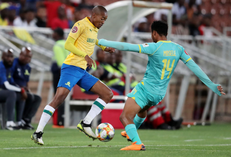Morena looks to avoid the tackle of Baroka's Goodman Mosele