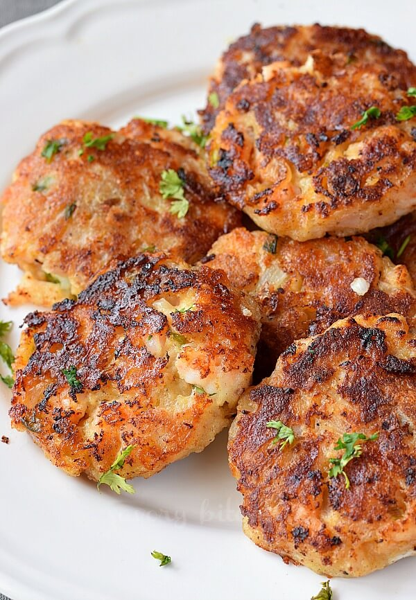 a pile of shrimp cakes on a white plate