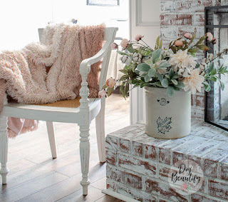 vintage chair, antique crock and flowers