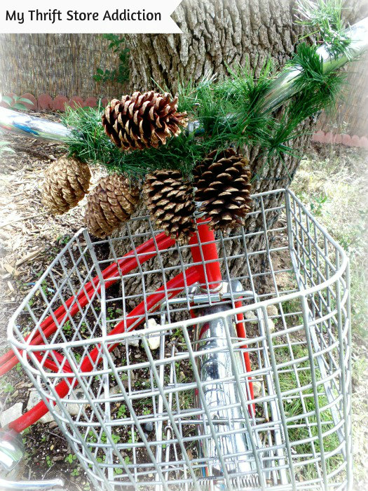 Friday's Find: Clearance Poinsettias to Deck My Halls... mythriftstoreaddiction.blogspot.com Adding garland and pinecones to my garden bike