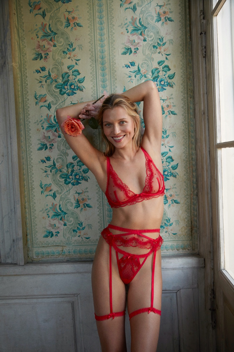 Looking red-hot, Hana Jirickova fronts For Love & Lemons x Victoria's Secret Holiday 2020 campaign.
