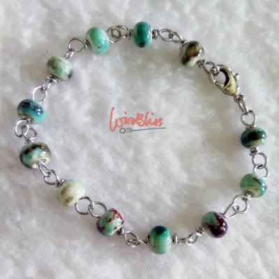 Wire wrapped ceramic beads bracelet