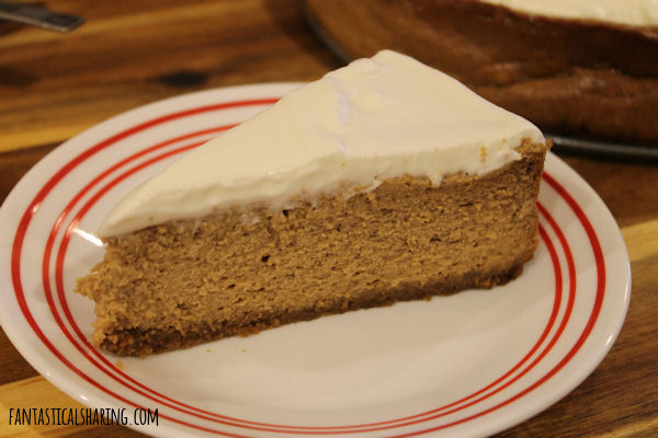 Gingerbread Cheesecake // This extraordinary holiday dessert has a gingersnap bottom, a creamy gingerbread and molasses cheesecake base, and is topped with a light and fluffy rum topping. #dessert #holiday #gingerbread #cheesecake #rum