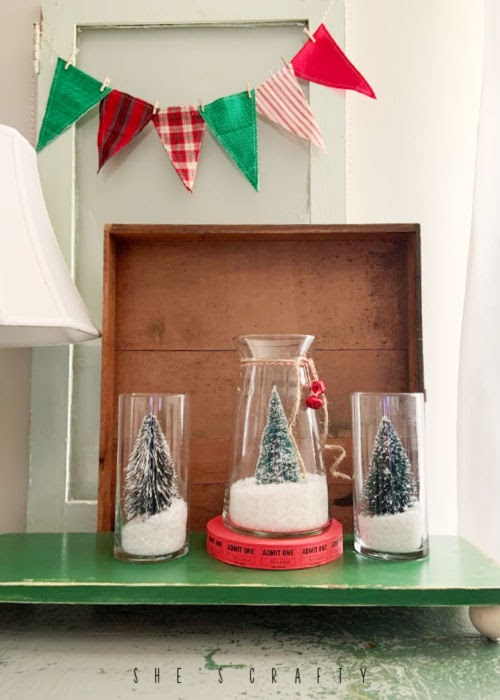 Christmas Vignette with DIY snow globes and bottle brush trees
