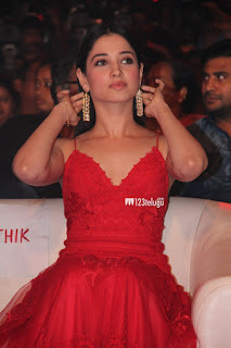 Tamannah Bhatia in a lovely Deep Neck Red Gown at Thozha Movie Audio Launch