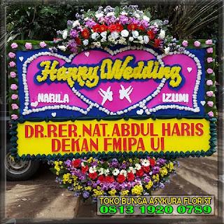 Toko Bunga Bekasi, Bunga Papan di Bekasi, Rangkaian bunga, karangan bunga, jual bunga, toko bunga, jual bunga papan, jual bunga meja, jual bunga krans, bunga ucapan, toko bunga di bekasi