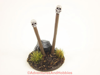 Front view of T1582 skull totems designed for 25 to 28mm scale miniature wargames.