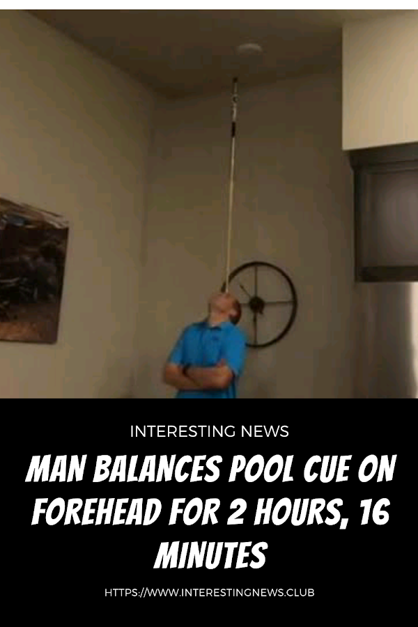 Man balances pool cue on forehead for 2 hours, 16 minutes |interesting news|