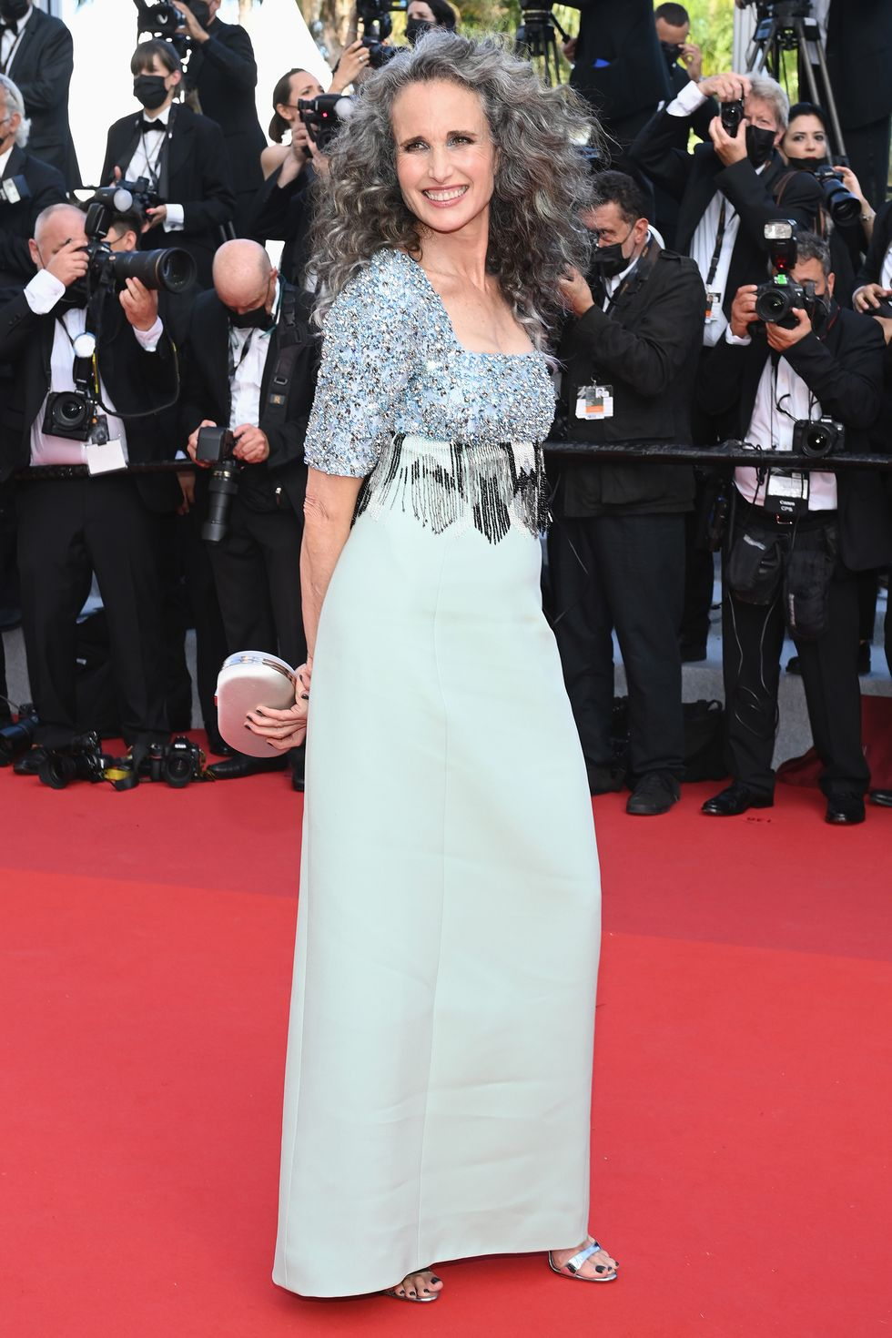 Andy McDowell The actress wore a classic silver-gray dress with an embellished bodice, and curly hair in natural tones.