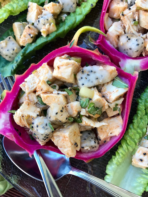 A twist on chicken salad using Thai red curry paste, coconut cream, fresh dragon fruit, and Thai basil for a delicious and fun light dinner or lunch.