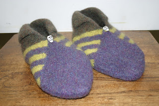 skull buttons and knitted stripes for my son's slippers!