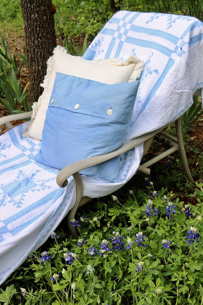 Add a quilt to a chaise lounge in the backyard if temperatures are cool