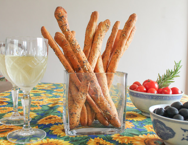Food Lust People Love: Crunchy and savory, these cheddar poppy seed bread sticks make the perfect munchable for snack time or even happy hour, with a cold glass of beer or wine of any color.