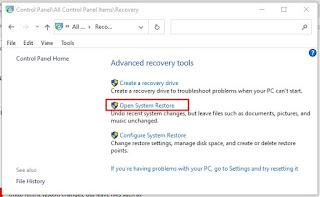 Klik Open System Restore