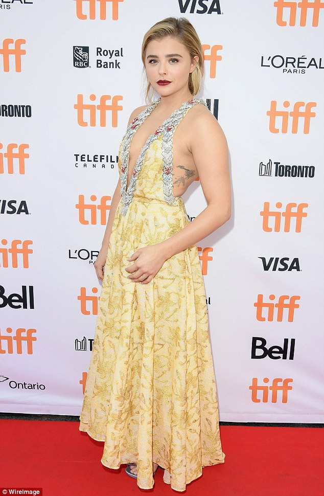 Chloe Moretz flaunts a plunging dress at the 'Brain on Fire' Toronto premiere