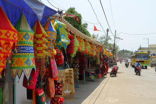 The main street of Pipili village showcasing the Chandua art in front of their stores
