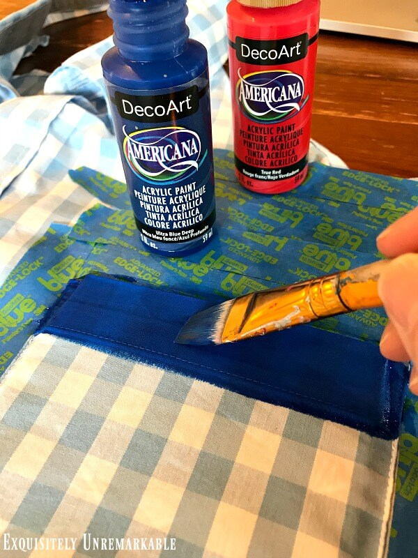 Painting the blue stripe on the top a shirt pocket