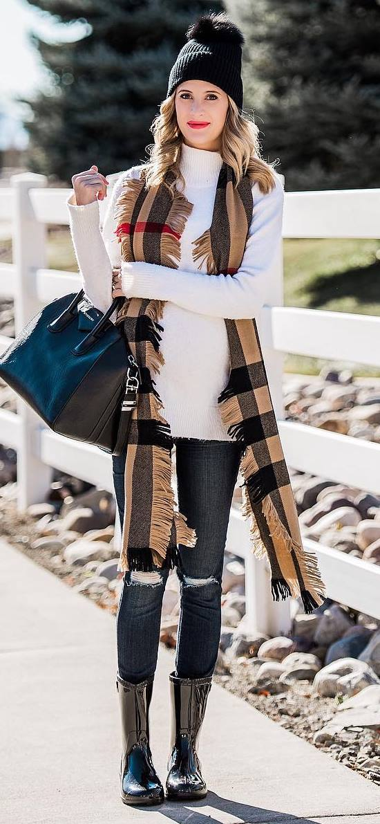 casual winter outfit idea / white sweater + plaid scarf + bag + rips + boots