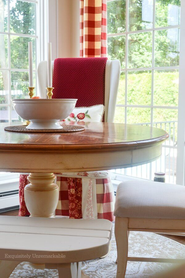 Cottage style kitchen table and chair with red checked curtain