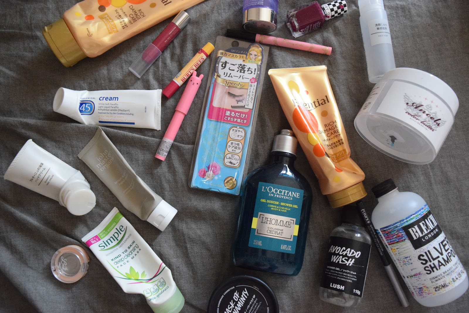 Flatlay of empty beauty products including skincare, makeup and hair care