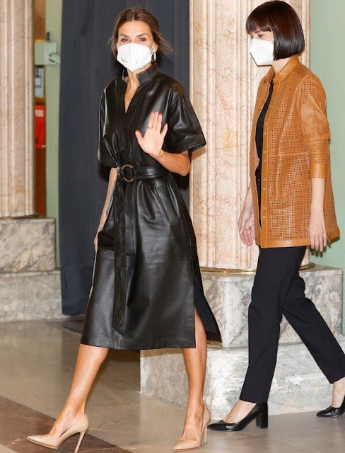 Queen Letizia wore a leather midi dress by Other Stories, leather pointed toe pumps by Prada. Coolook earrings