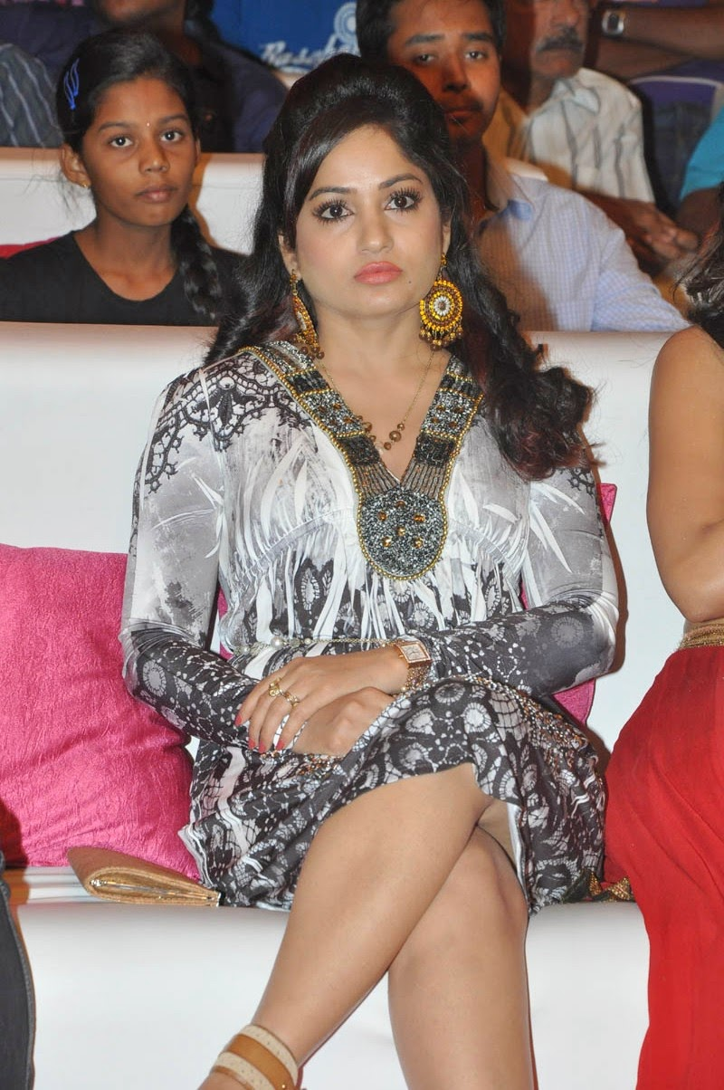 Madhavi Latha Hot Sitting Crossed Legs At Pooja Movie Audio Launch