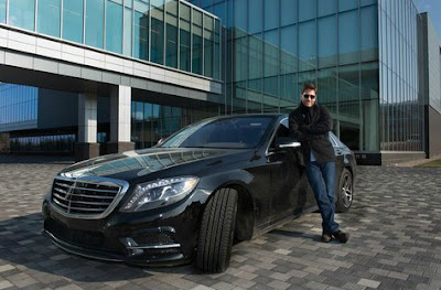Mike Greenberg posing for a photo with his car