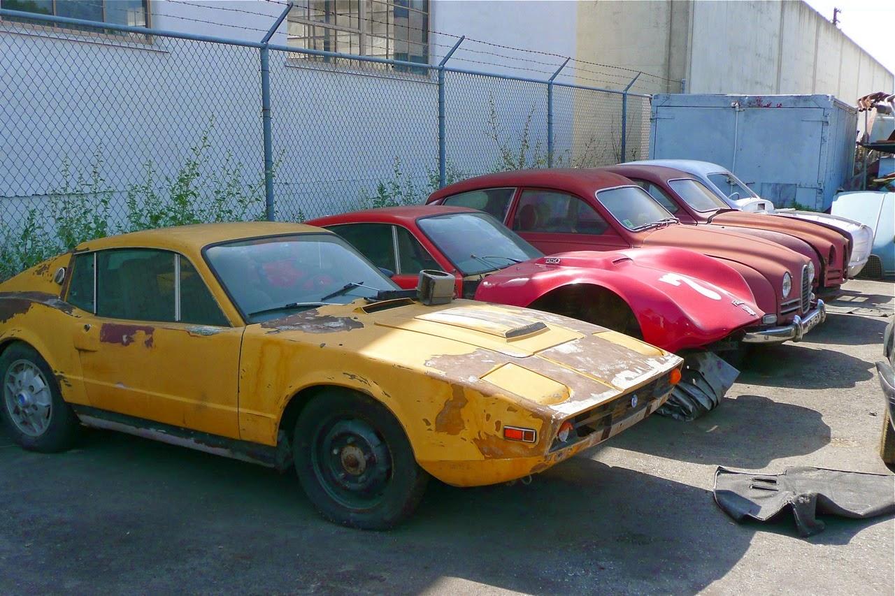Scenes in a classic Saab shop, racing cowl