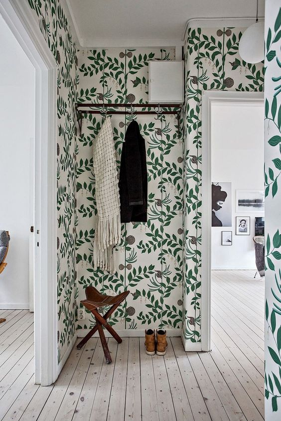 entry with green vine wallpaper