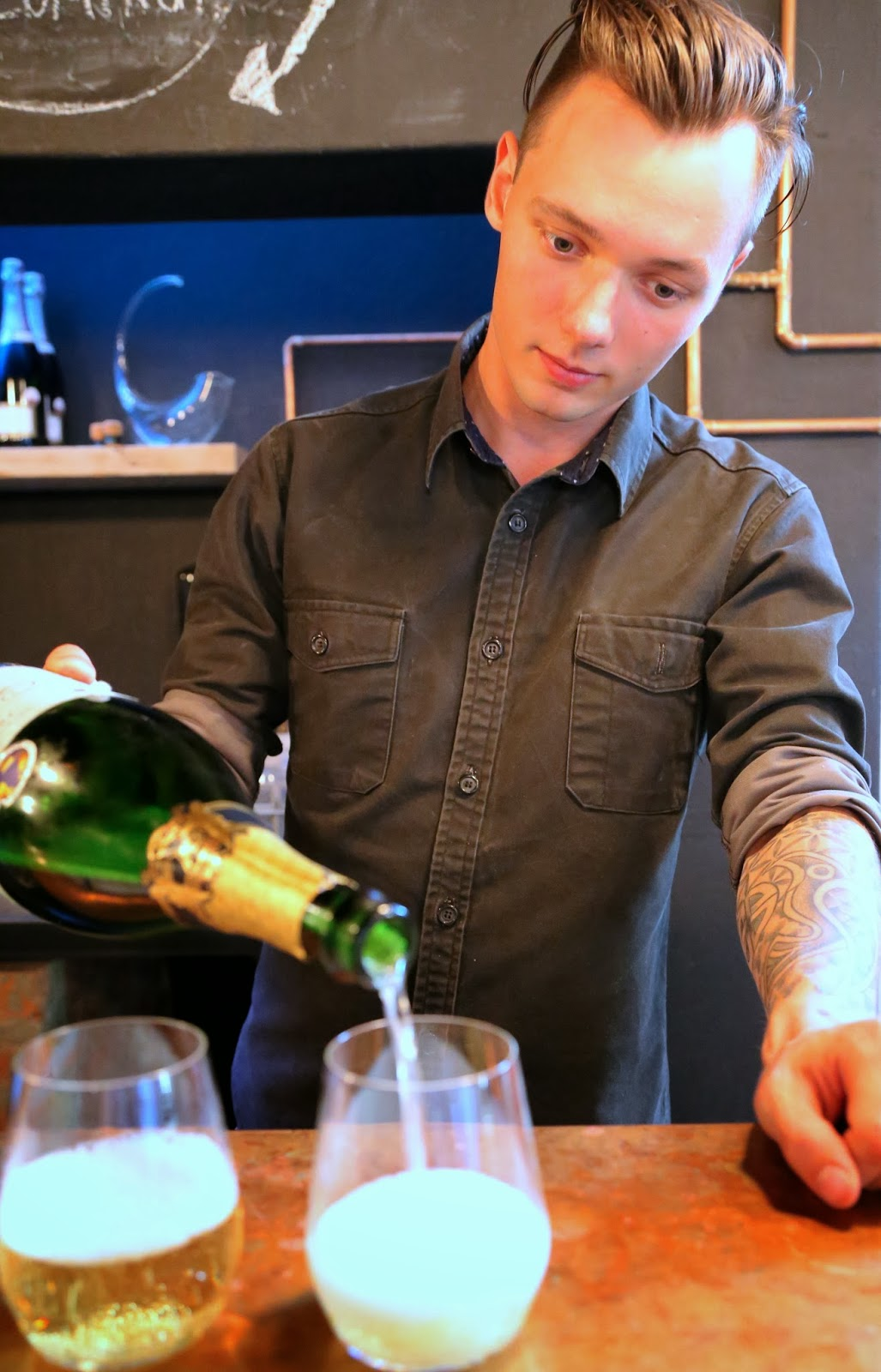 Pouring sparkling wine at Publik, Cape Town.