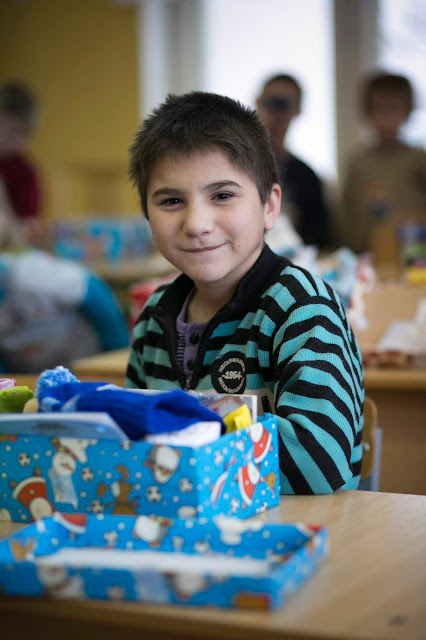 Boy receiving shoebox gift in Belarus