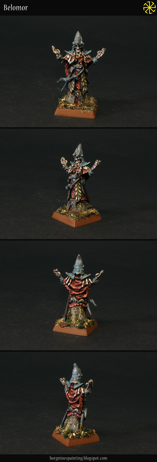 A single Liche miniature from Frostgrave on a square base, adapted to be used as a necromancer in WFB or AoS. He has metal details painted to look like verdigris and various robes in red and black.