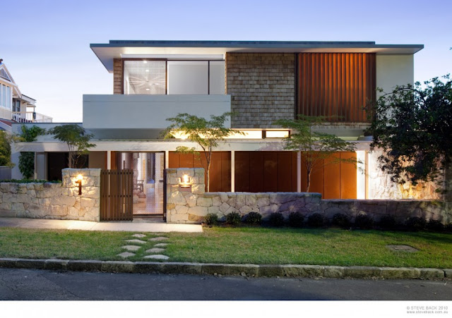 Contemporary River House by MCK Architects from the street