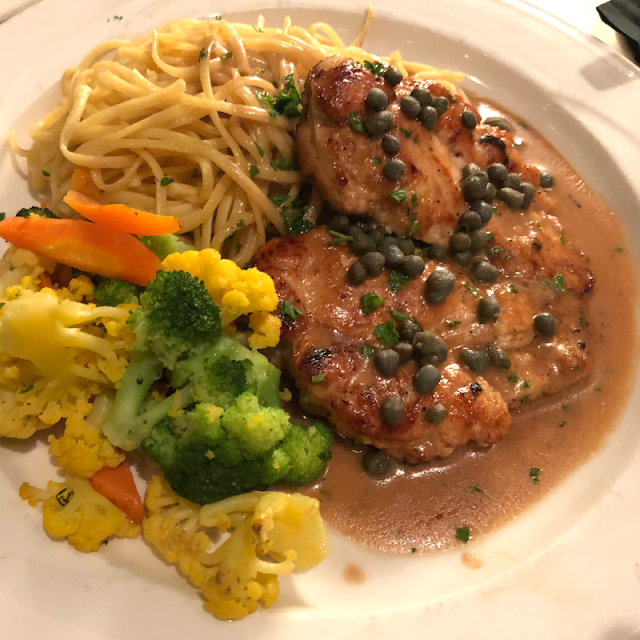 Chicken Piccata with vibrant vegetable medley at Palm Court in Arlington Heights