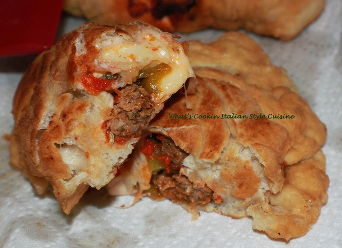 this is a stuffed pizza with meat and cheese in a dough deep fried