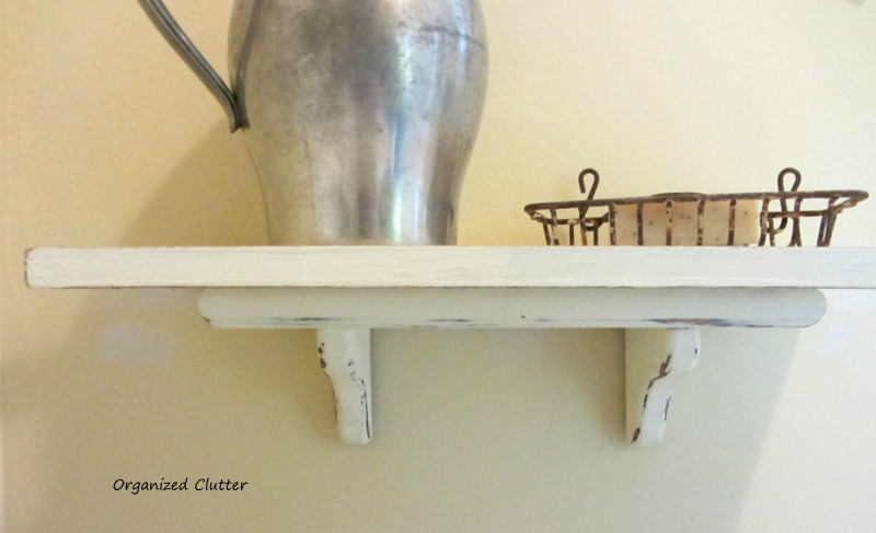 Adding a Shutter to a Thrift Shop Shelf www.organizedclutterqueen.blogspot.com