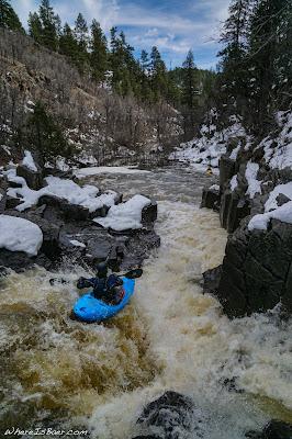 Ted Decker sliding into Mexican Pocket, pump house wash kayak snow cold WhereIsBaer.com Chris Baer