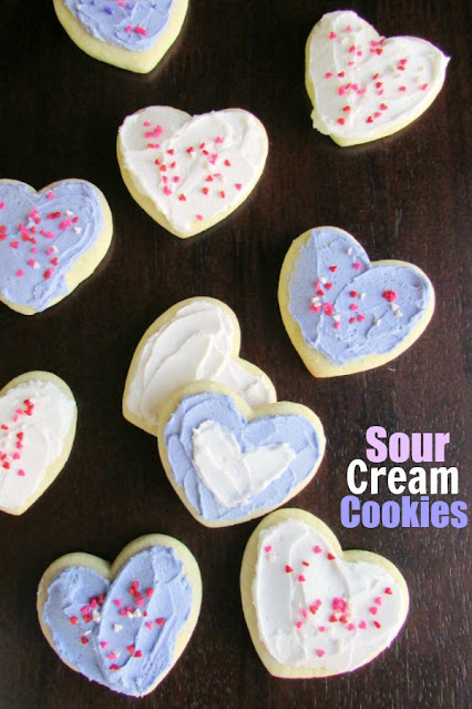 sour cream cookies cut into hearts and decorated with buttercream
