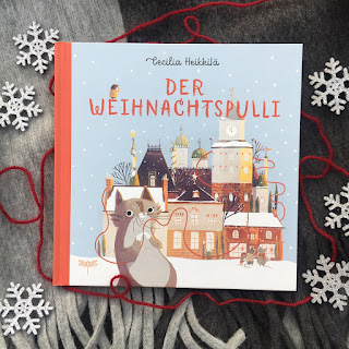 """""""Der Weihnachtspulli"""" von Cecilia Heikkilä, erschienen im Dragonfly Verlag, ist ein 32-seitiges Weihnachts-Bilderbuch für Kinder ab 3 Jahren, Rezension auf Kinderbuchblog Familienbücherei"""