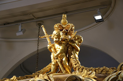 herubs on the roof of the Gold State Coach at the Royal Mews, Buckingham Palace
