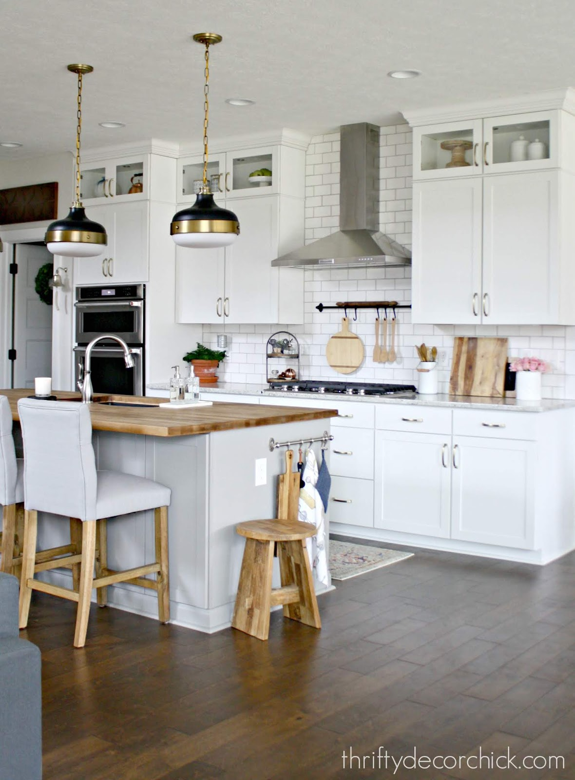 light gray island white kitchen